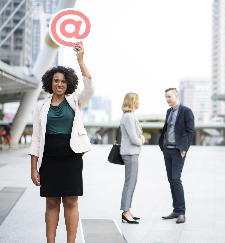 woman raising hand holding at icon