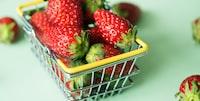 closeup photo of strawberries in baket
