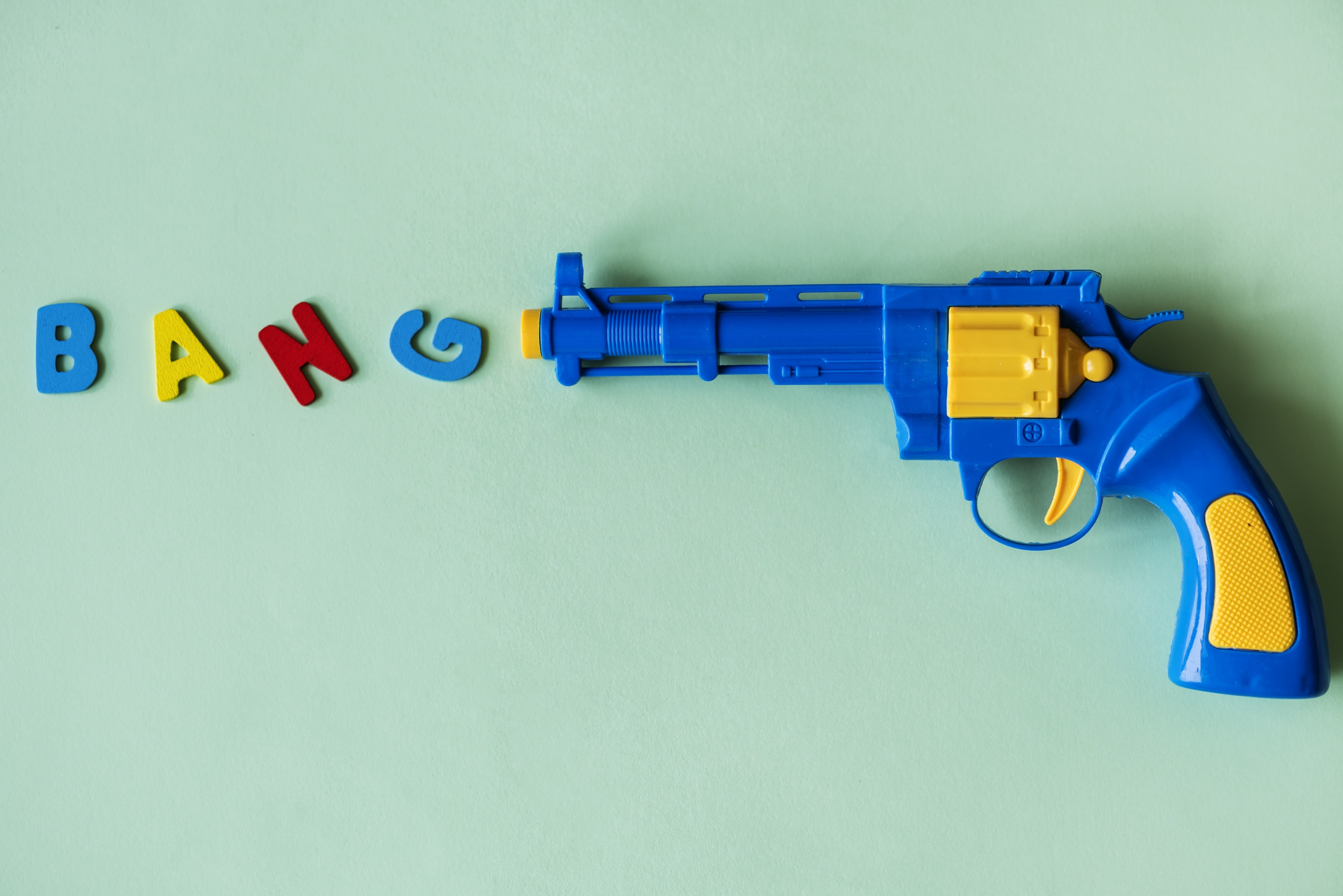 children's blue and yellow plastic gun