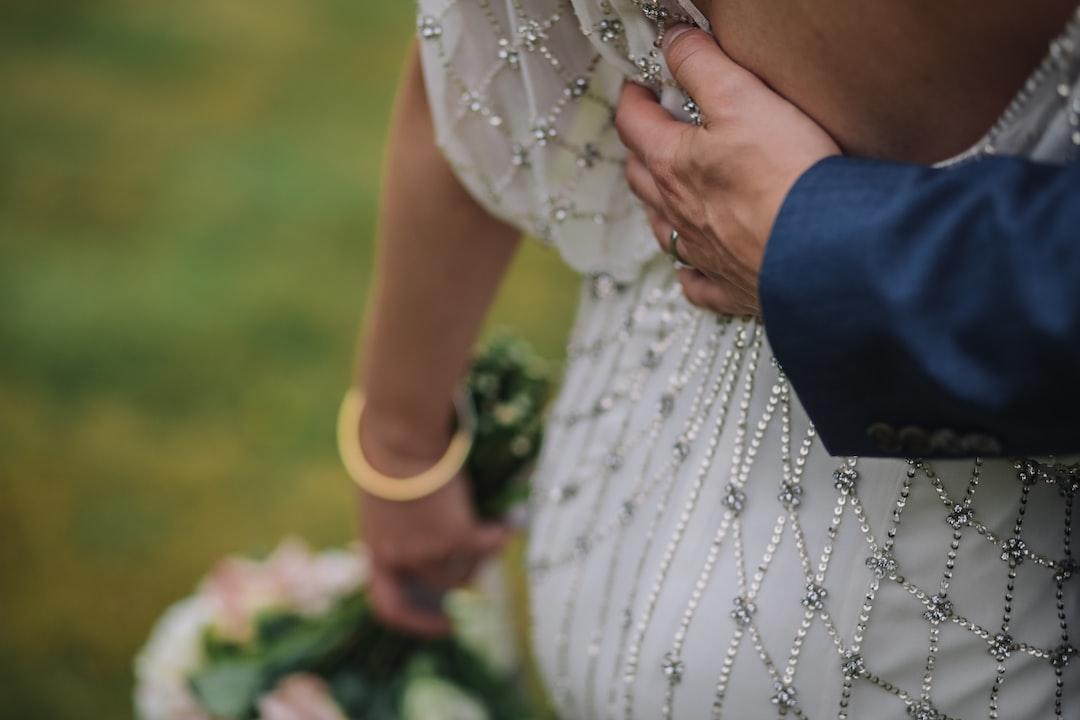 Groom holding bride on her back