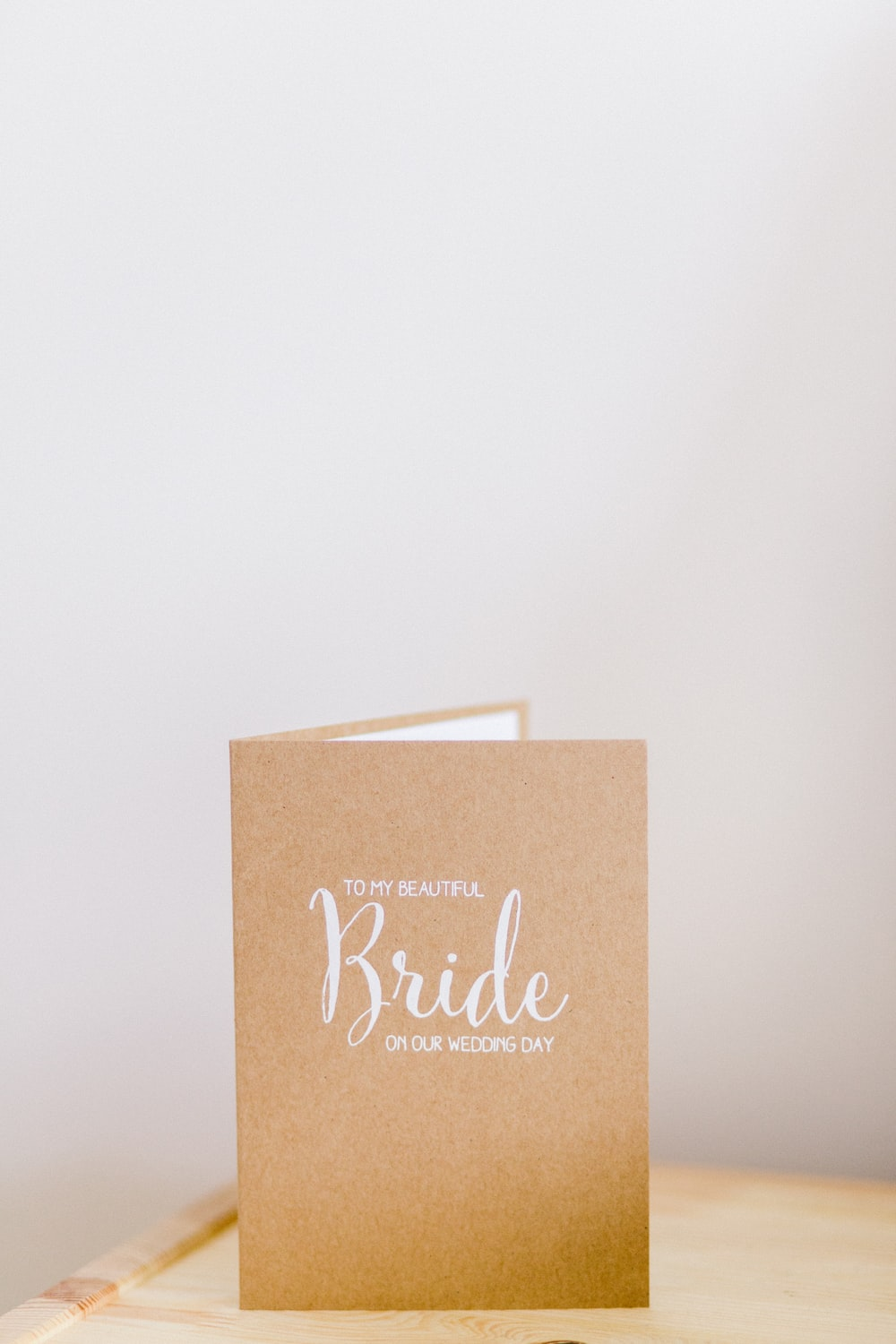 brown to my beautiful wife on our wedding day greetings card on brown panel