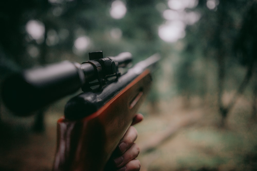 selective focus photography of brown hunting rifle