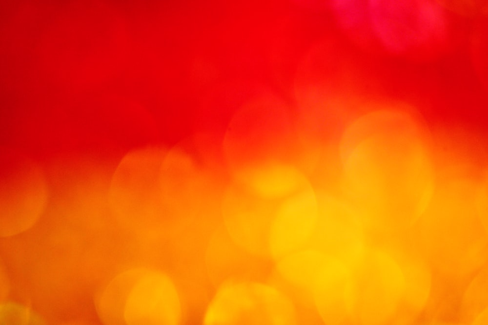 Warm Red And Orange Bokeh Fire Backgr...