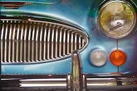 blue car showing grille