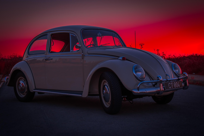 white Volkswagen Beetle on road way