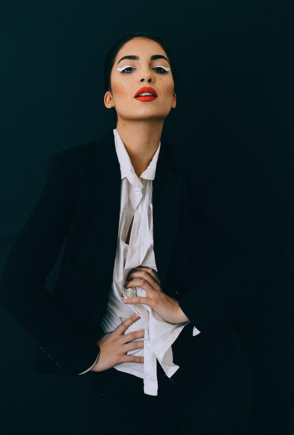 woman wearing black blazer and white dress shirt