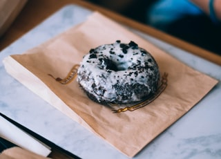 cookies and cream donuts on brown paper