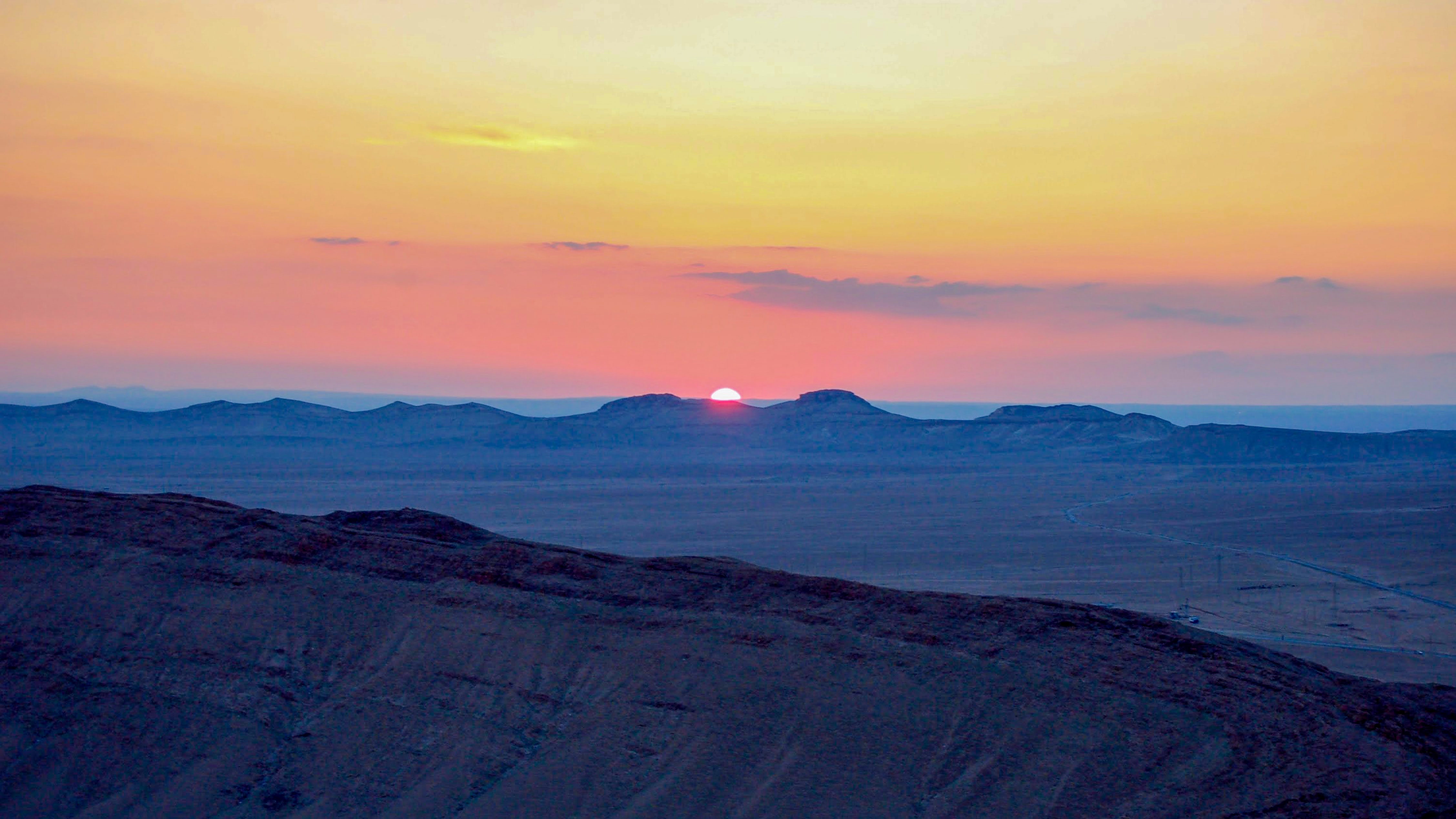 landscape photograph of mountain ranges during golden hour