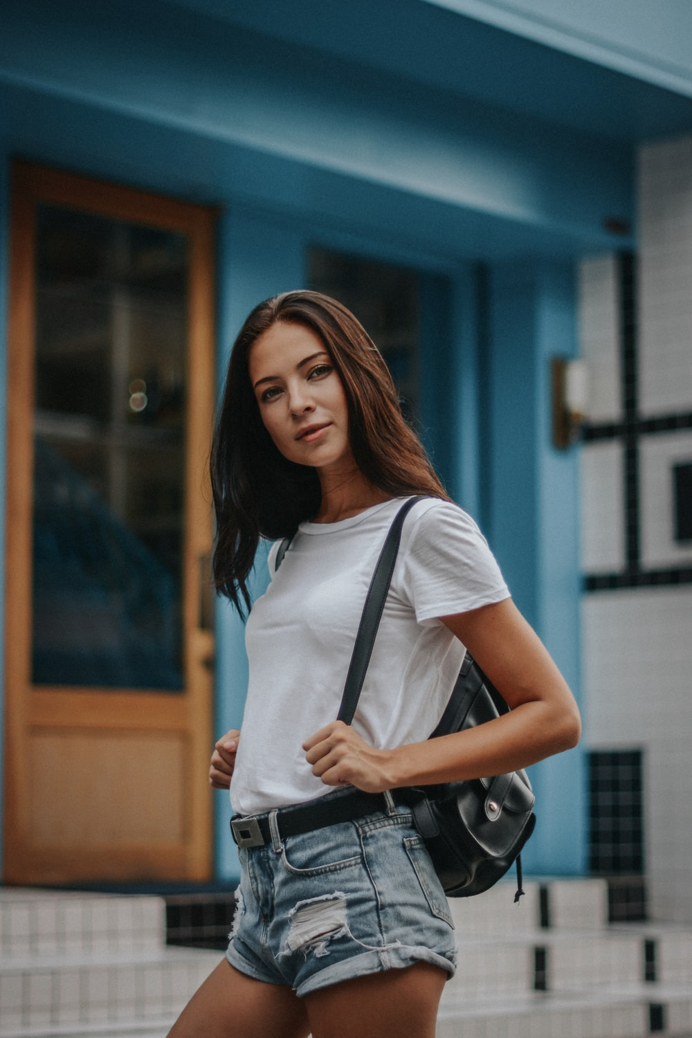 woman in white shirt standing