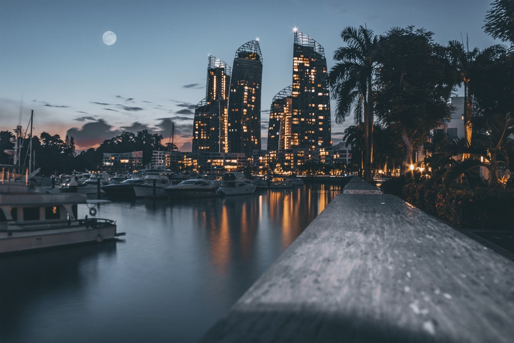 high-rise buildings near body of water during dusk