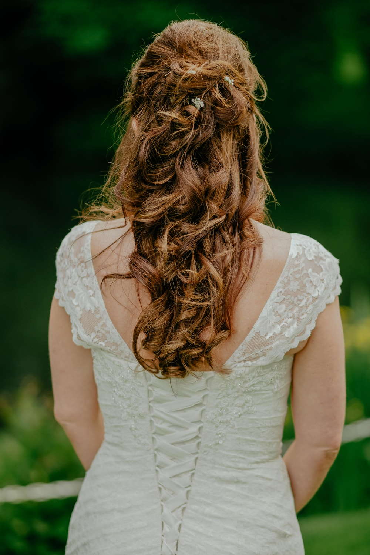 woman wearing white lace sleeveless top