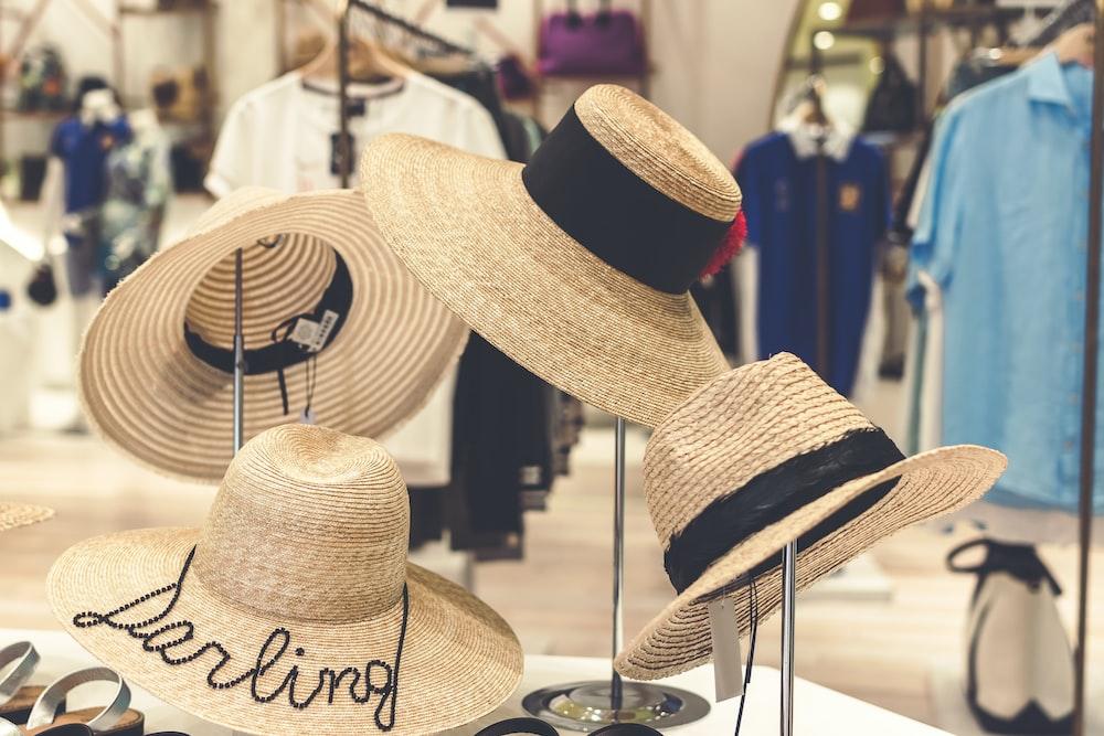 women's four sun hats on table