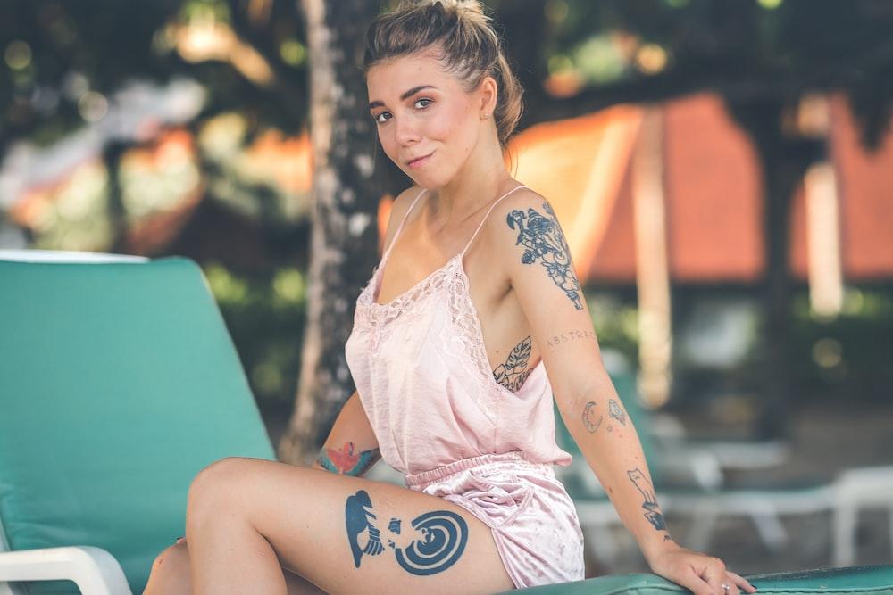 woman wearing pink nighties sat on sunlounger