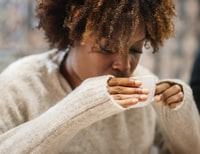 woman sipping on white ceramic up
