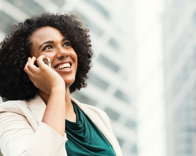 smiling woman talking to the smartphone