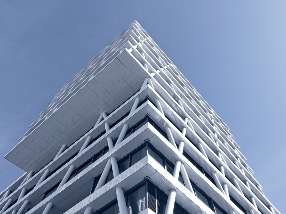 low-angle photo of white high-rise building