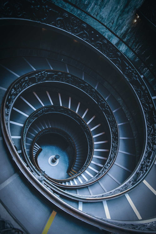 closeup photo of black spiral stairs