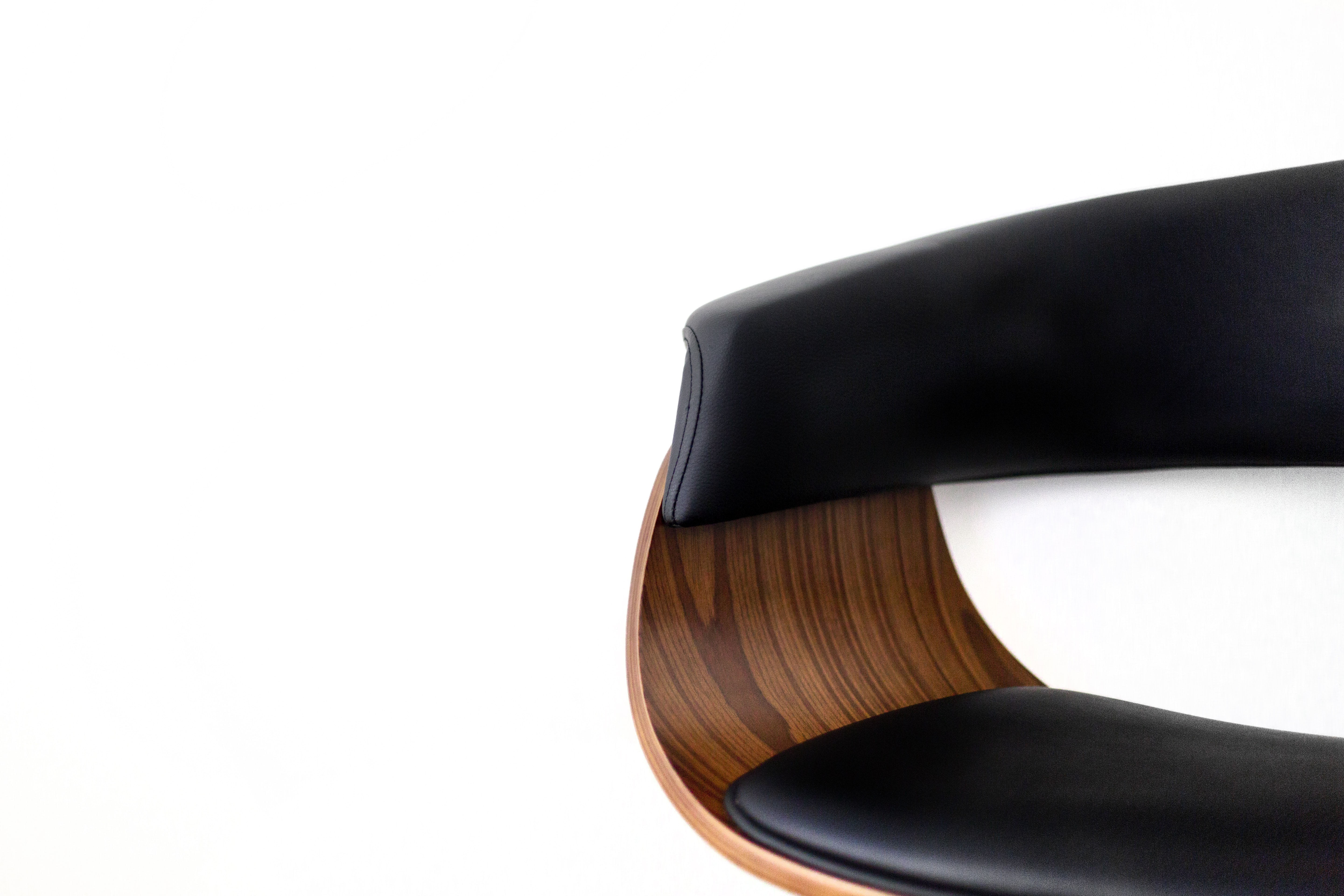 brown and black chair against white background