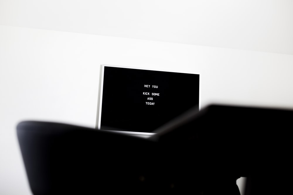 white flat screen television on white wall