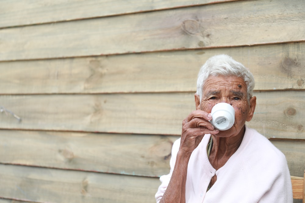woman drinking on teacup