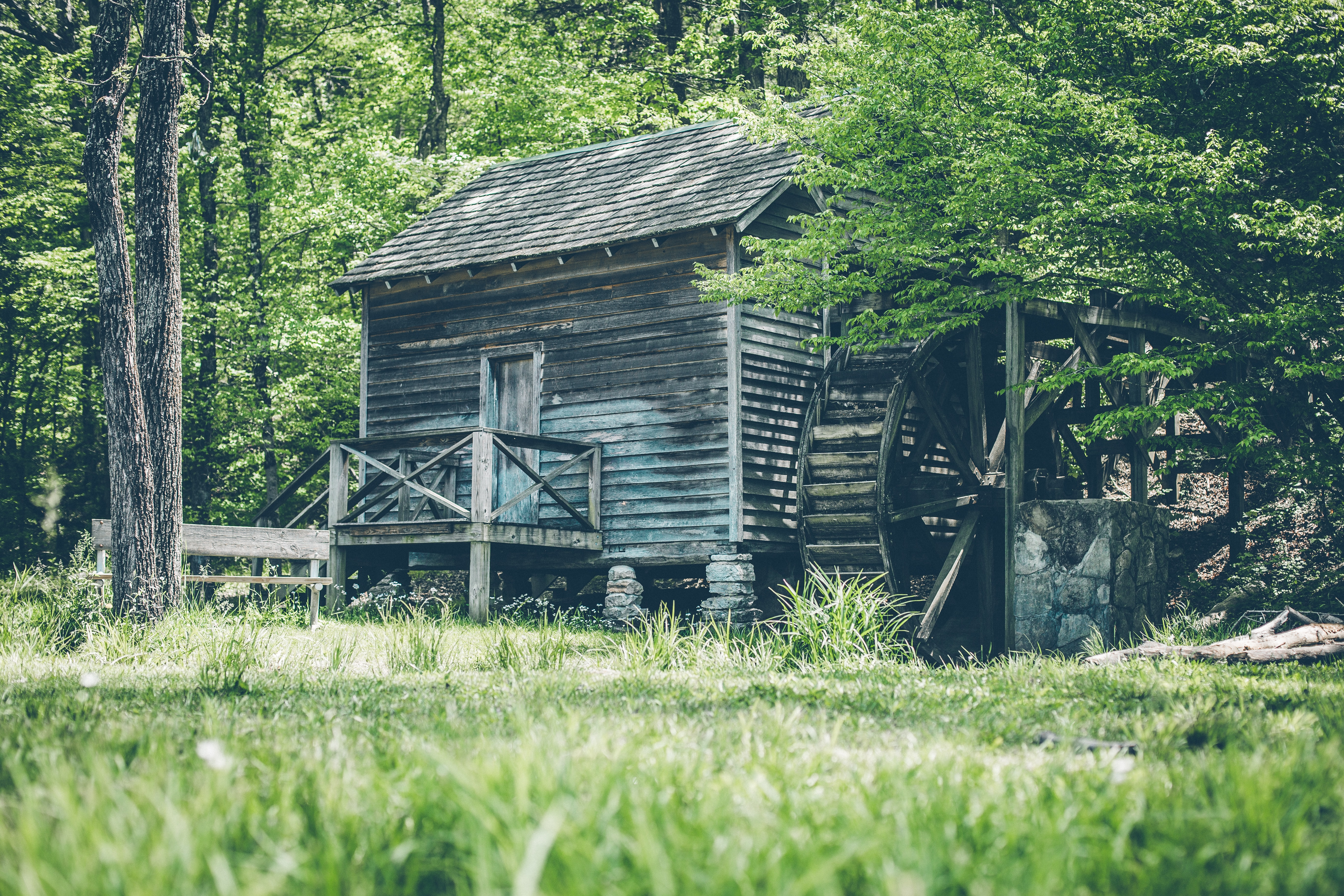 gray wooden shed with watermill