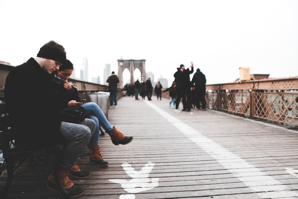 people sitting and walking on dock