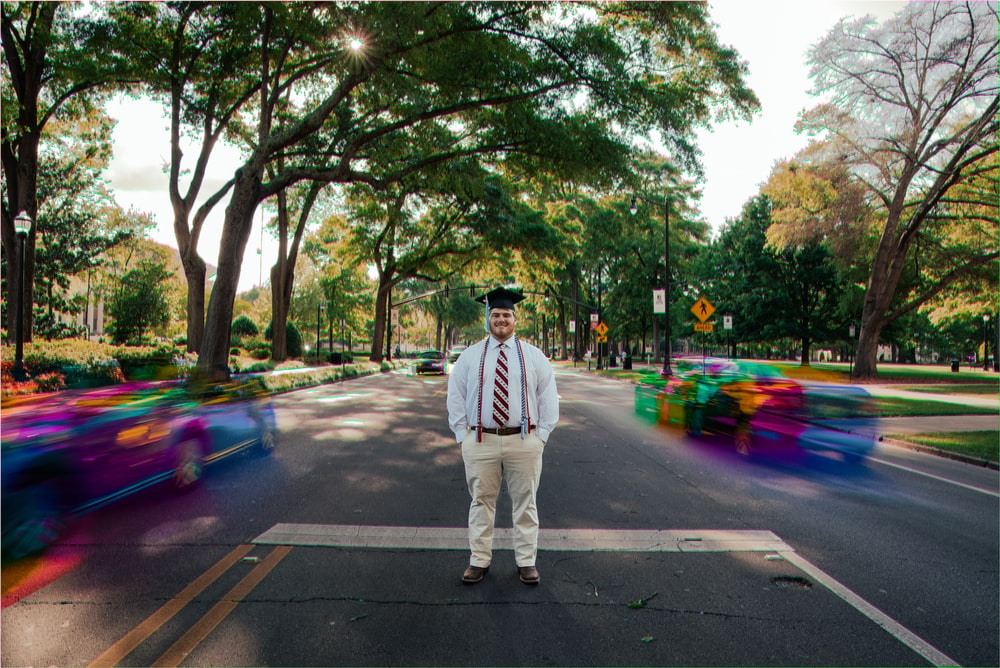 man standing at the center of road