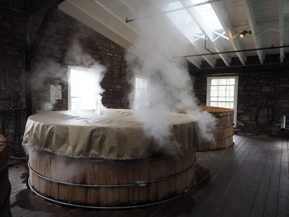 photo of wooden hot tub inside room