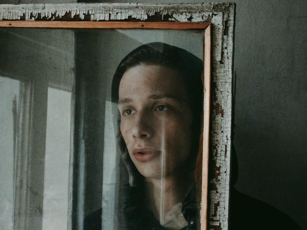 man facing glass window
