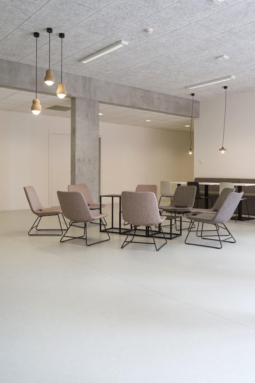 brown fabric padded sofa set inside room