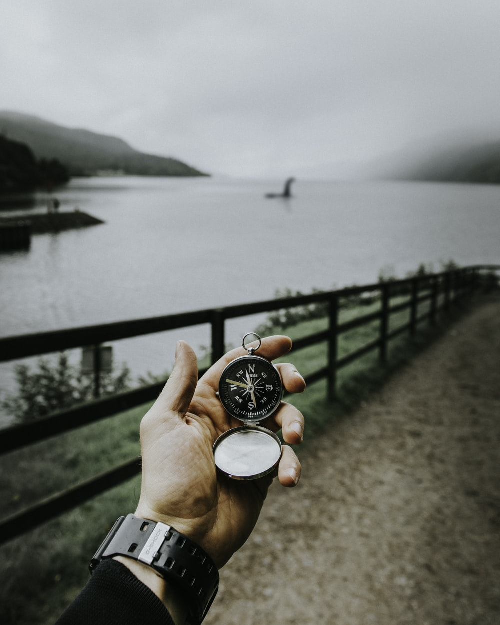 person using compass that leads to Loch Ness place