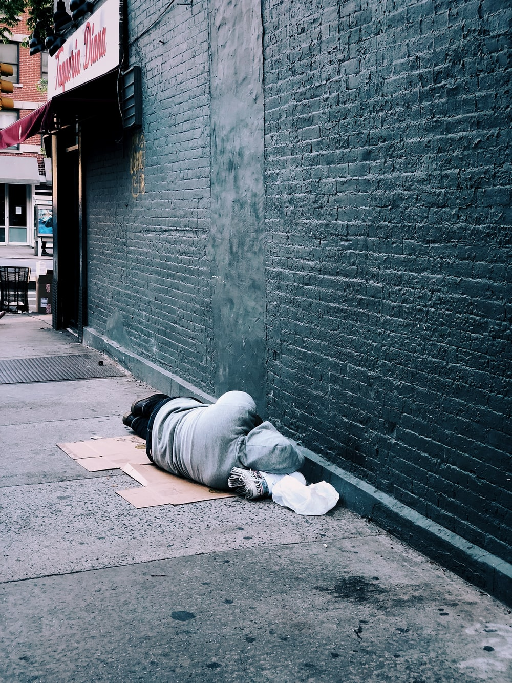 man lying on brown cardboard box