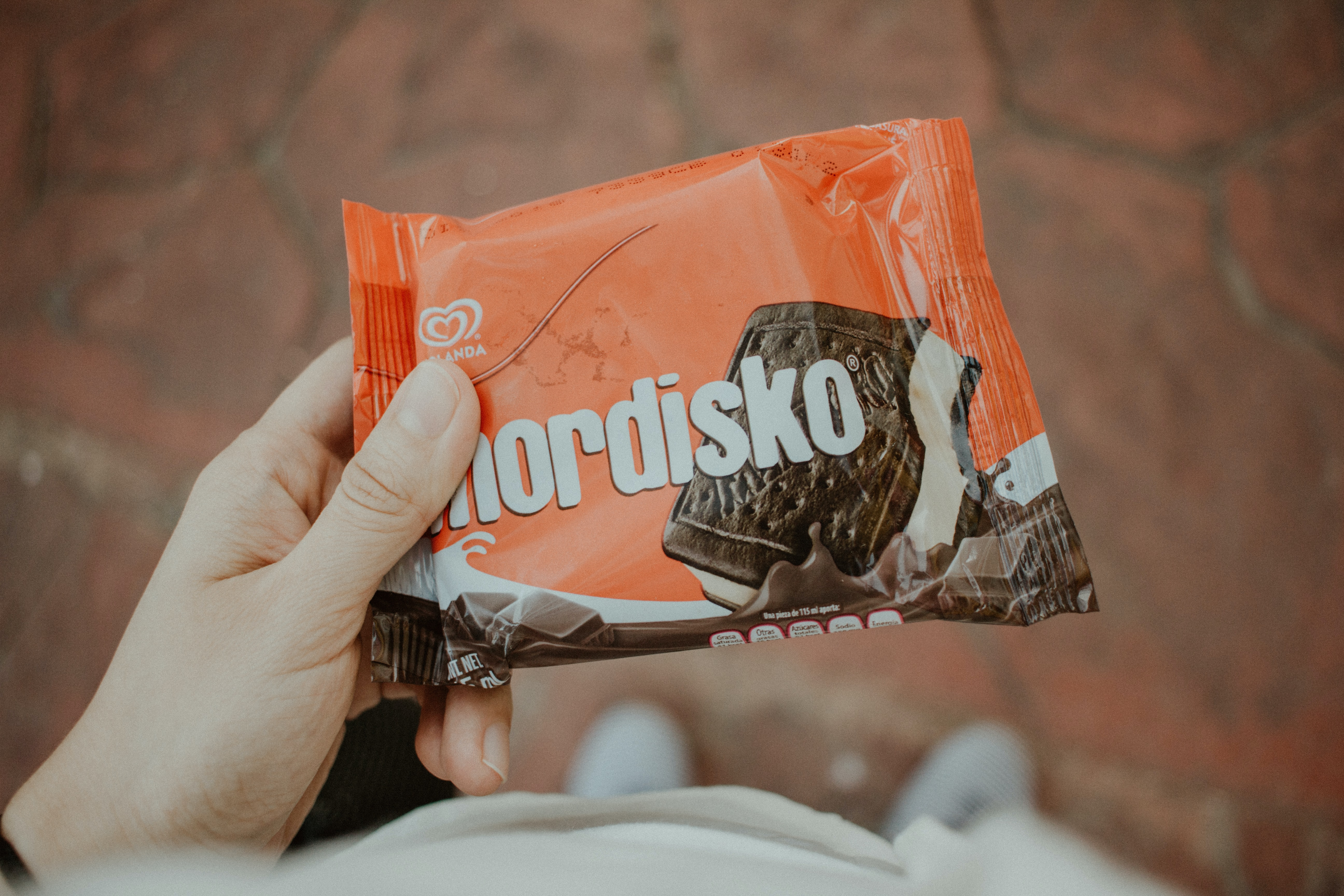 person holding Nordisko biscuit pack
