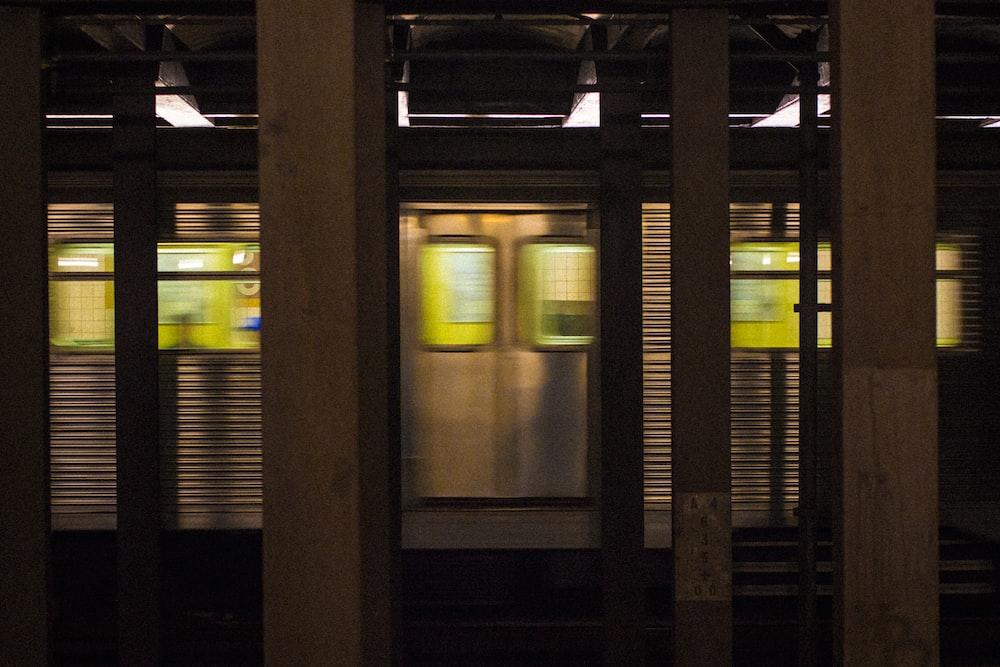 photo of gray train in subway