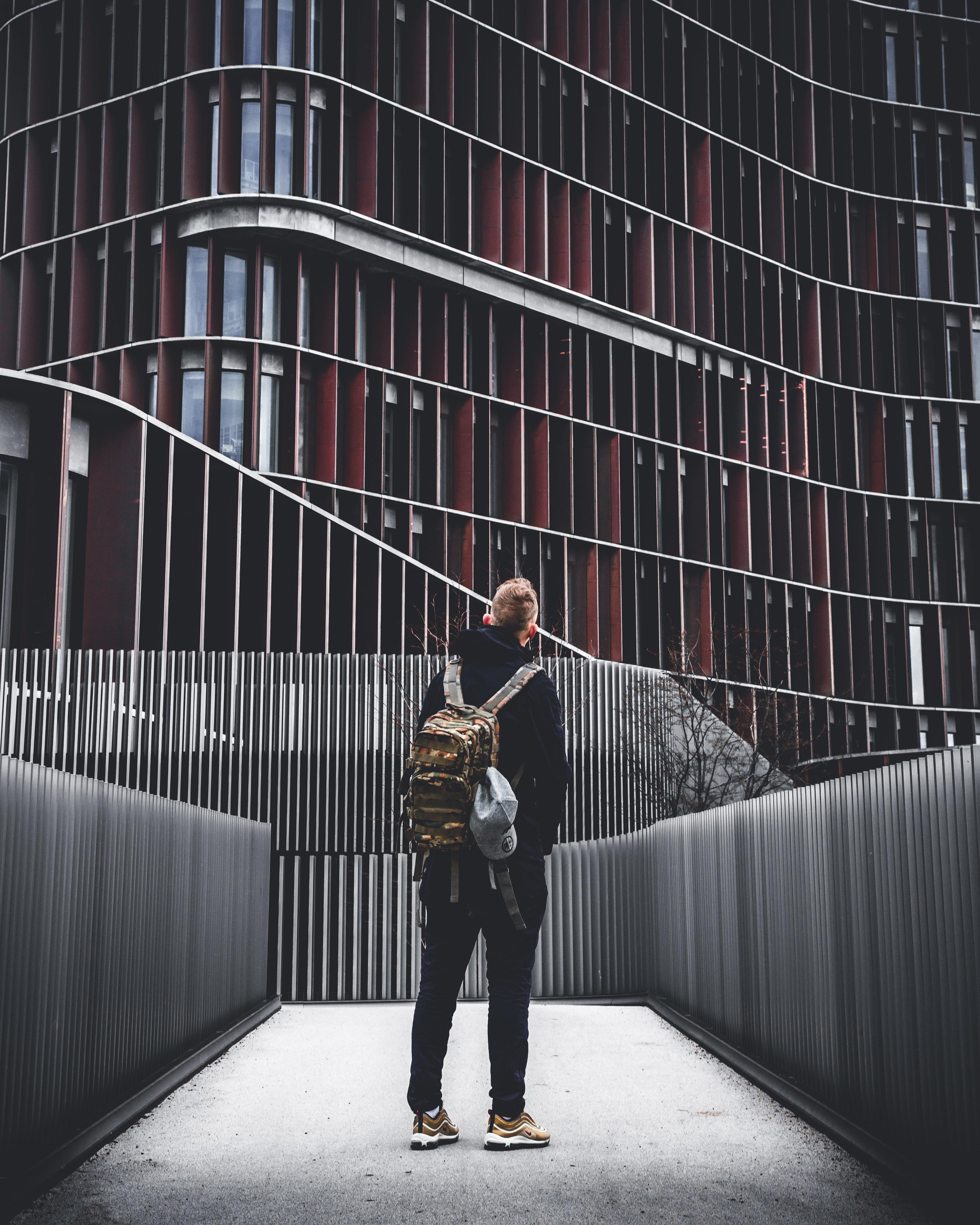 man standing under building