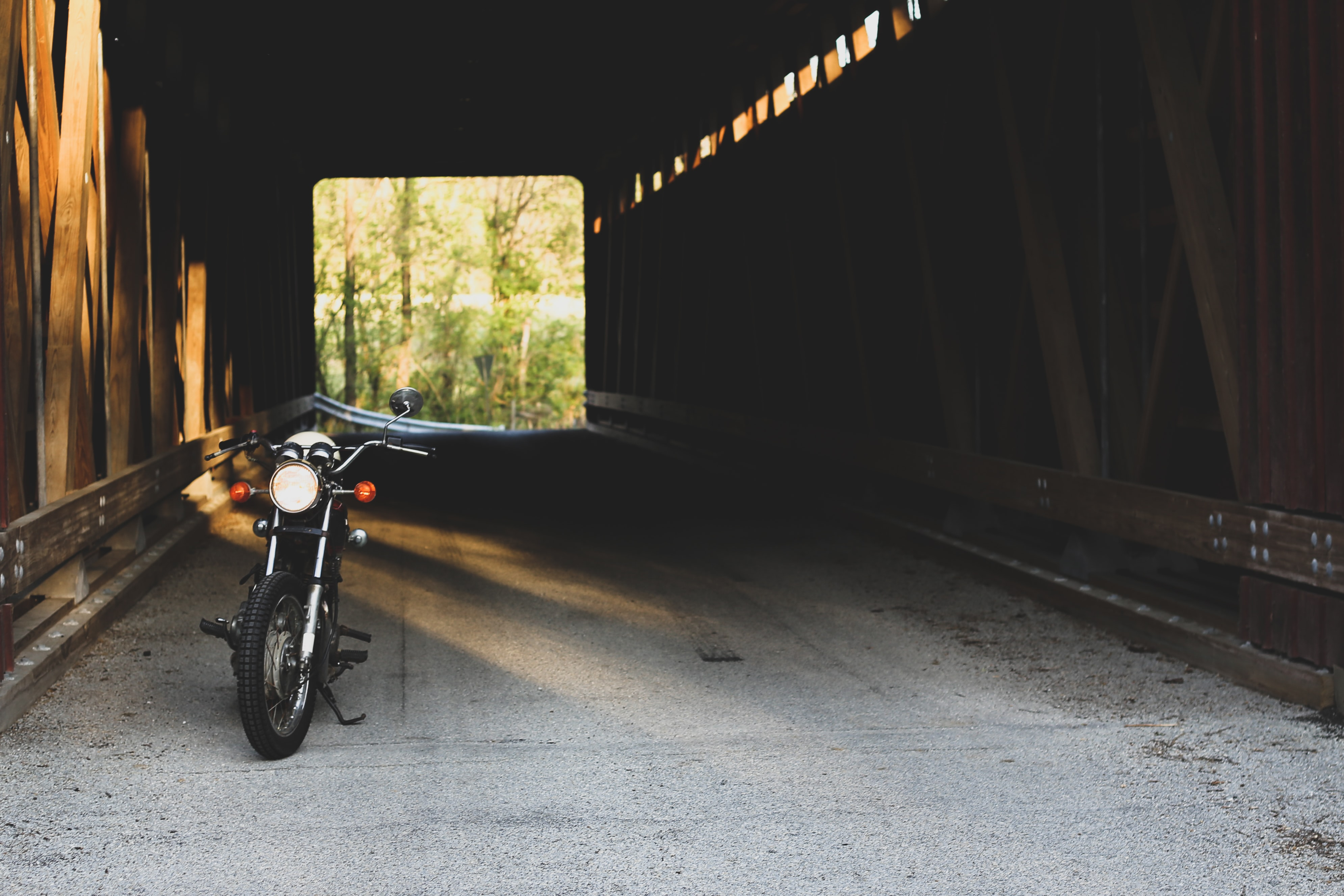 black motorcycle parking inside the tunnel