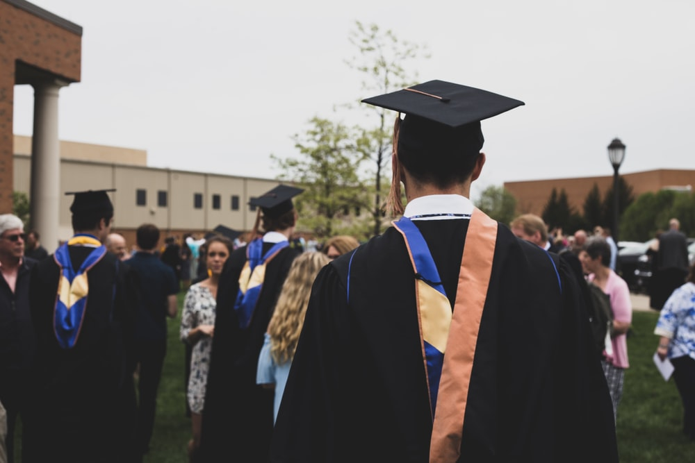 man wearing academic gown