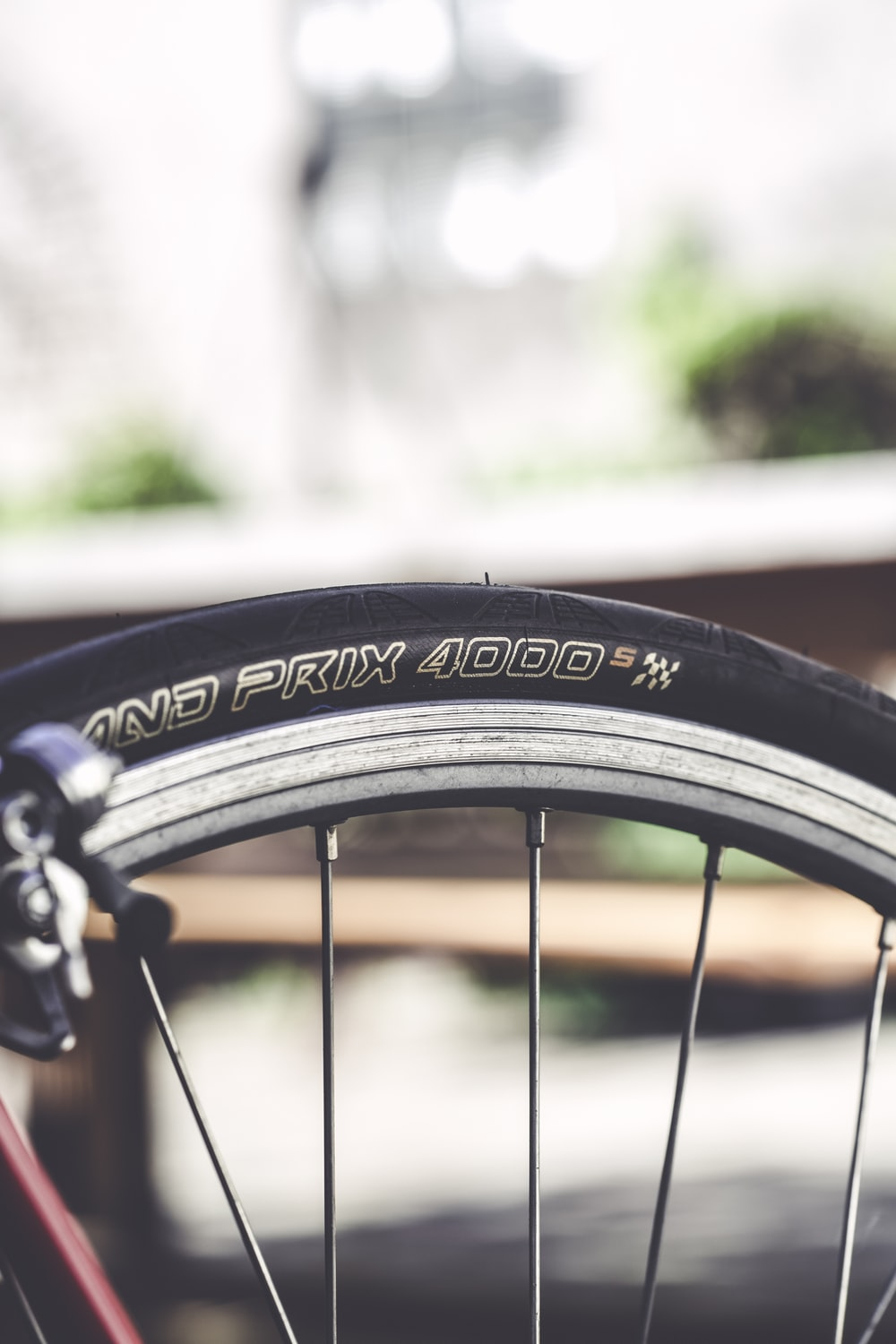 shallow focus photo of bicycle wheel