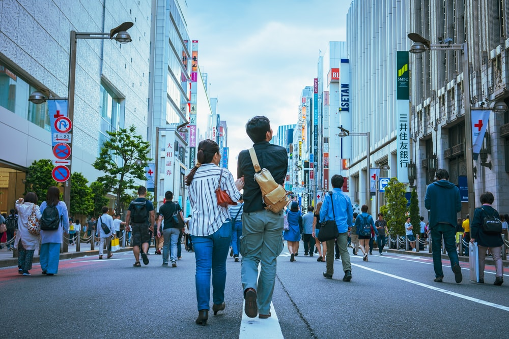 people walking on asphalt road