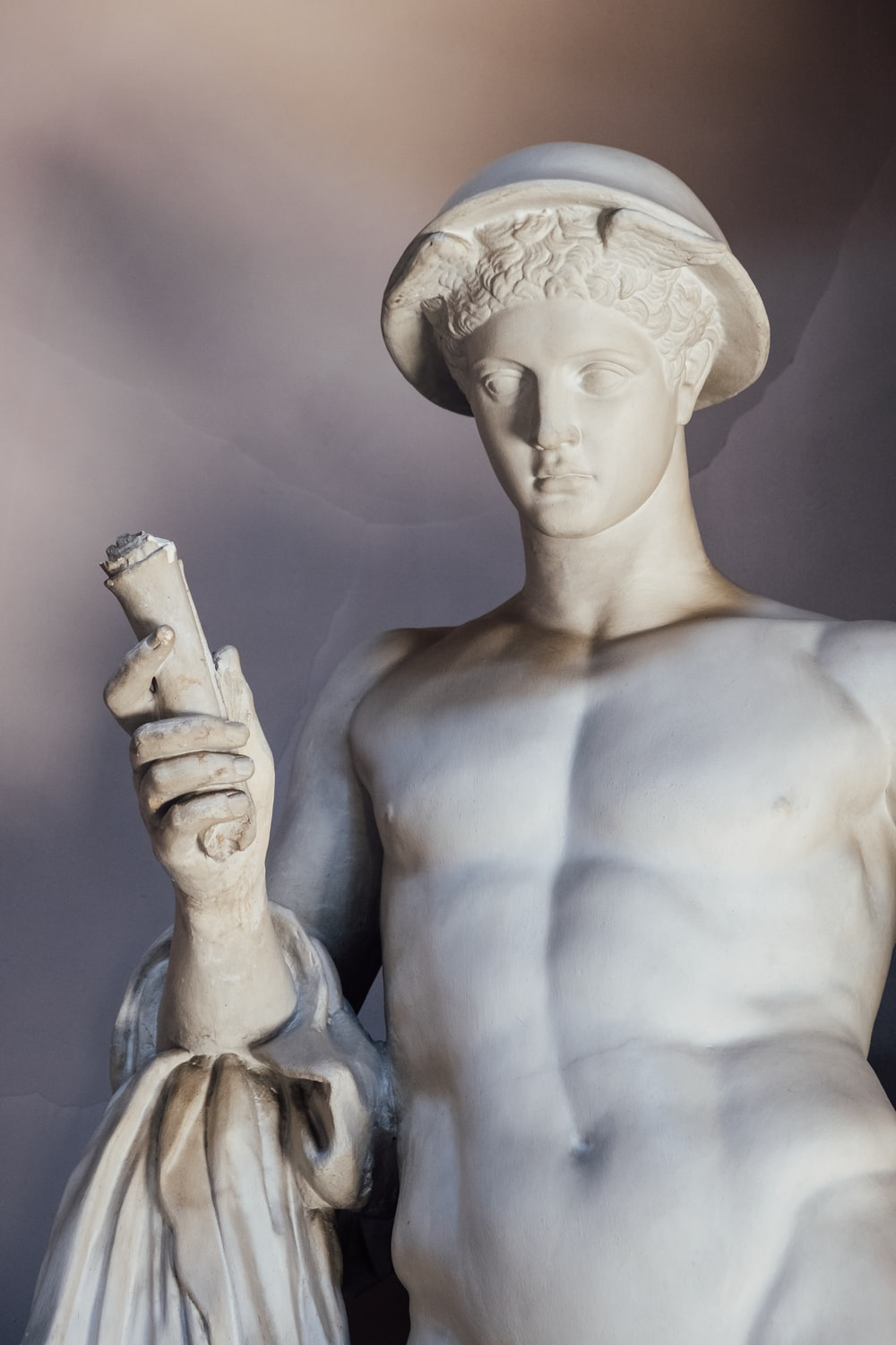 man holding pipe statue