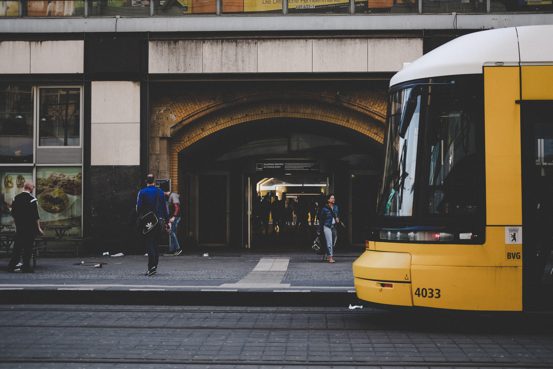 man standing near yellow bus
