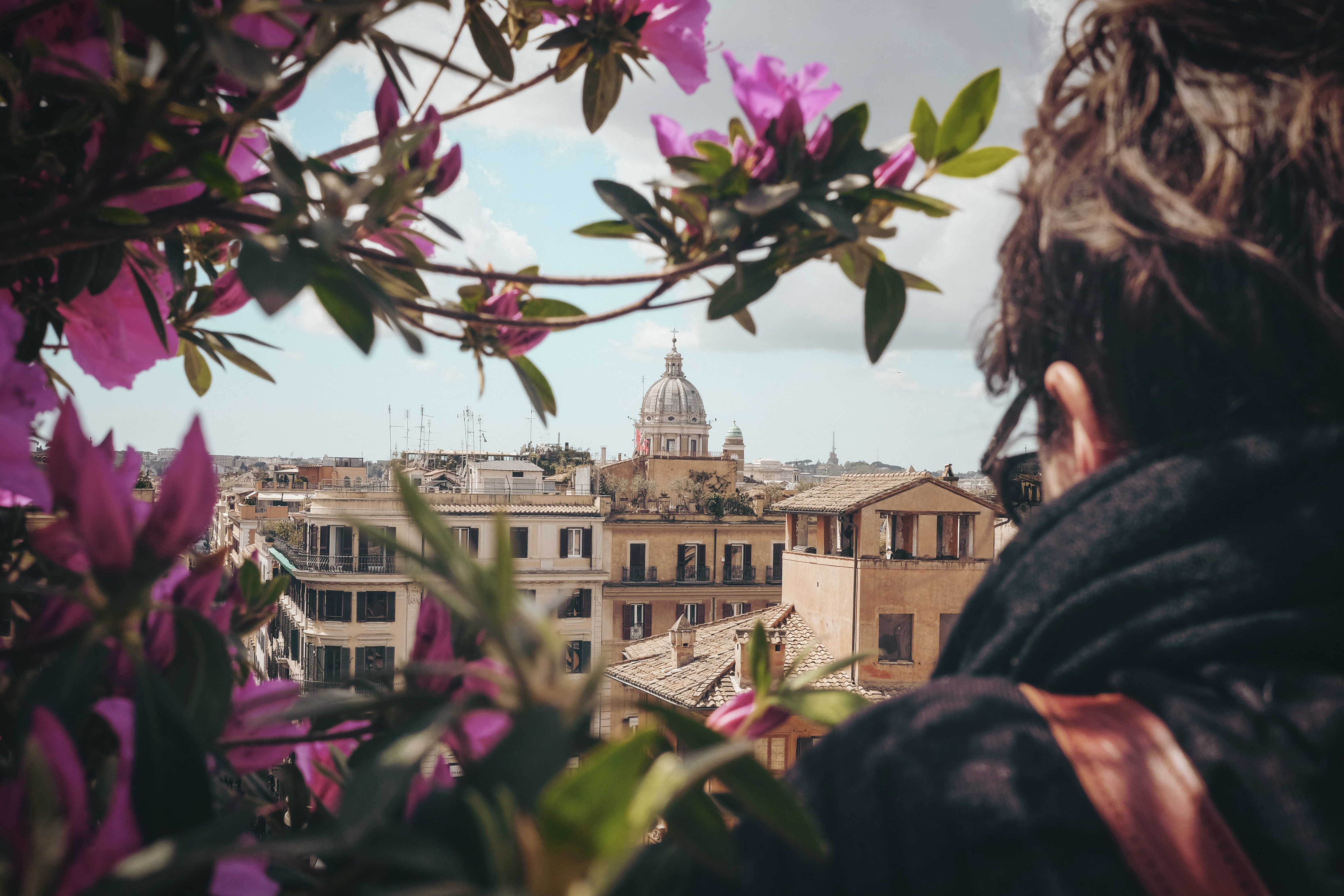 selective focus photography of man facing concrete building during dayitme