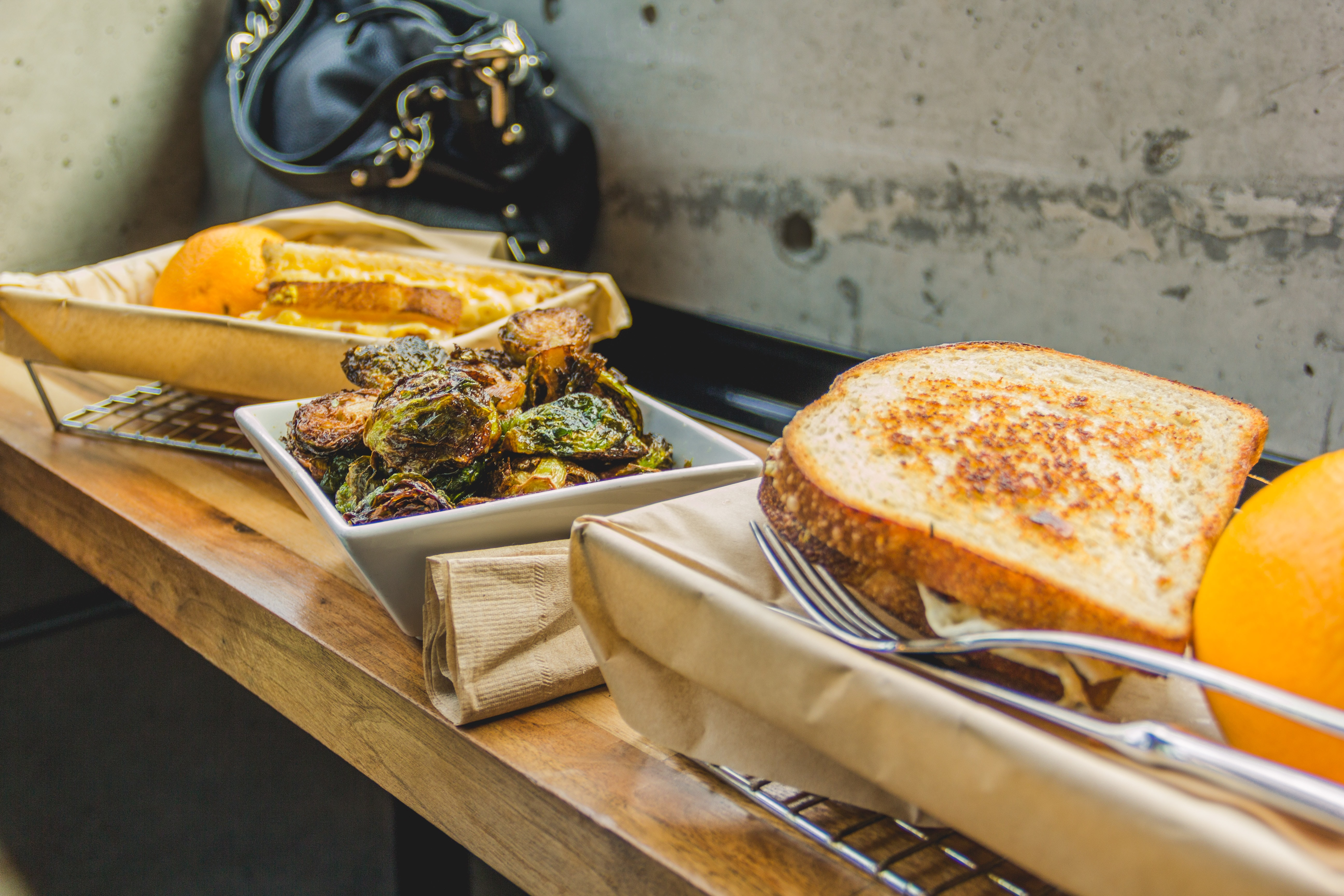 baked bread on metal basket near white wall