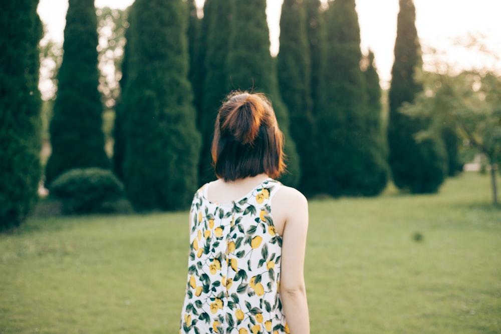 woman walking on lawn during daytime