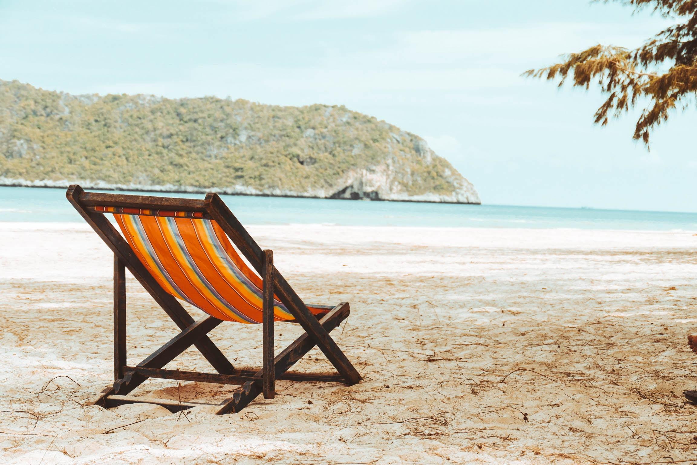 photo of lounge chair on beach