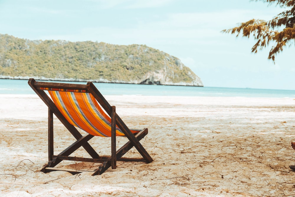 photo of lounge chair on beach