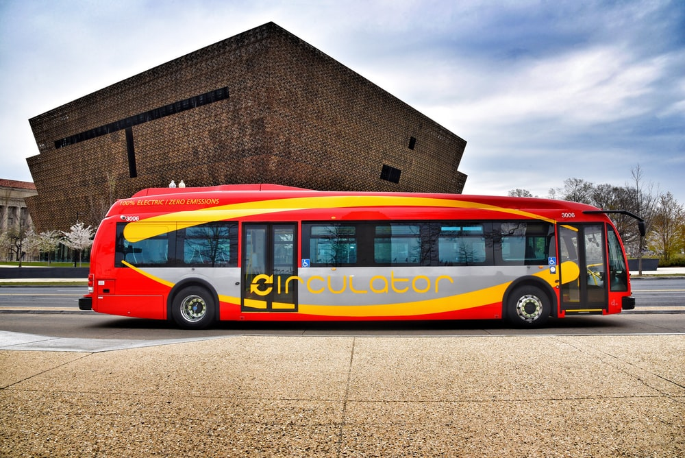 red, gray, and yellow bus