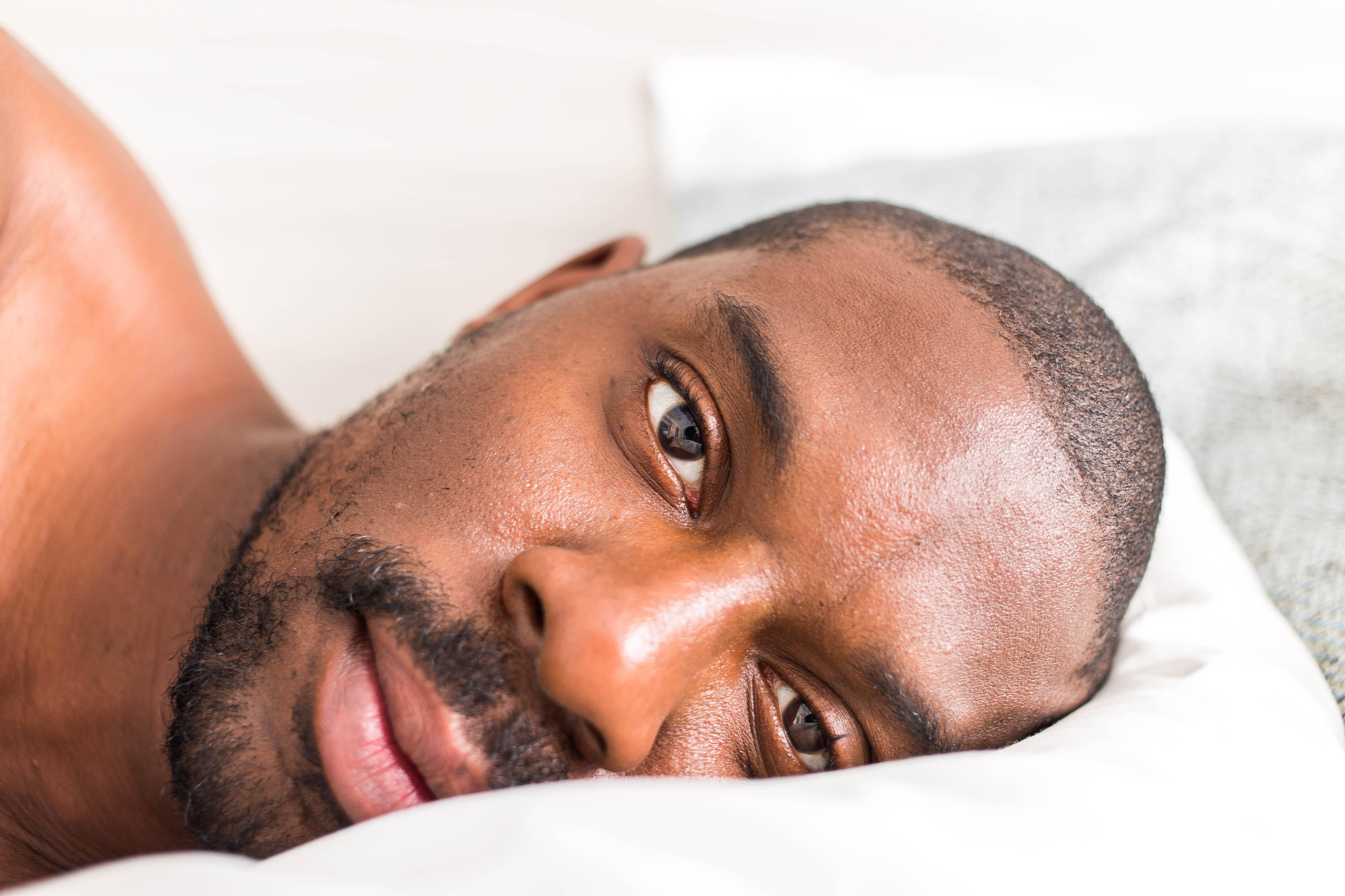 man lying down on bed