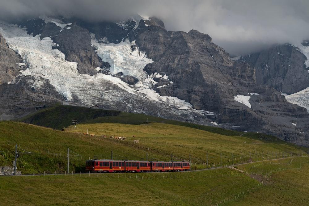 red train near mountain