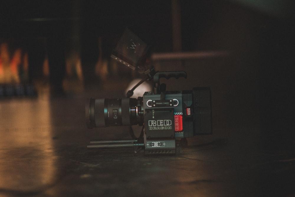 tilt shift lens photography of black professional camera
